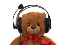 Toy teddy bear wearing head set Stock Photography