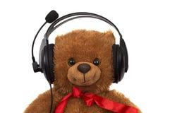 Toy teddy bear wearing head set Stock Photography