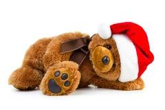 Toy teddy bear wearing a santa hat Stock Photos
