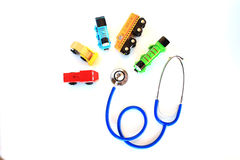Toy Thomas train and stethoscope, symbolizing children healthcare / pediatric care Royalty Free Stock Images