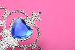 Toy tiara with blue gem Stock Photos