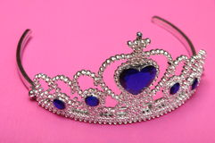 Toy tiara with blue gem Royalty Free Stock Photography
