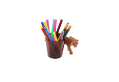 Toy tiger and crayons in a glass. Stock Photo
