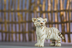 Toy tiger in front of fence Royalty Free Stock Images