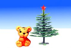 Toy tiger at a toy new year tree Stock Photography