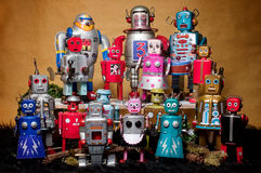Toy Tin Robot Gathering 01. Toy tin robot gathering on brown background Royalty Free Stock Photos
