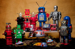 Toy Tin Robot Gathering 02. Toy tin robot gathering on brown background Stock Photo