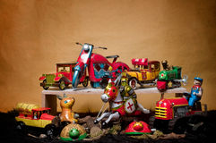 Toy Tin Robot Gathering 04. Toy tin robot gathering on brown background Royalty Free Stock Images