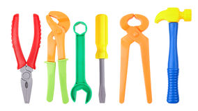 Toy tools. Plastic color isolated on a white background Stock Photos