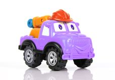 Toy tow truck. A toy purple tow truck with helmet stock photography