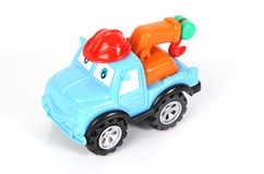 Toy tow truck. With a red helmut royalty free stock photos