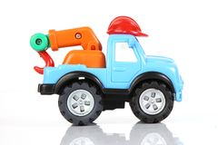 Toy tow truck. With a red helmut royalty free stock image