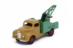Toy towing truck. Vintage toy towing truck. Isolated against a white background Royalty Free Stock Photos