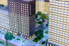Toy town. Tilt shift blur effect. The cityscape of the housing estate modern skyscrapers royalty free stock image