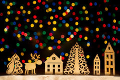 Toy town - Xmas lights stars, Christmas tree, vintage wooden dec Royalty Free Stock Photo