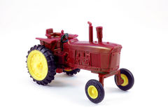 Toy Tractor. Red toy tractor isolated on white Royalty Free Stock Images
