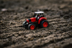 Toy tractor on the field Stock Photos