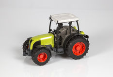 Toy tractor. Toy green tractor for children Stock Image