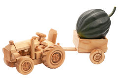 Toy tractor with green pumpkin. Stock Image