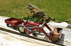 Toy tractor, loader, and trailer Royalty Free Stock Photos
