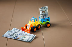 Toy tractor with money on table Stock Images