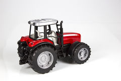 Toy tractor. Red tractor toy on a white background Stock Image
