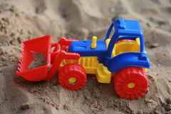 Toy tractor on the sand Royalty Free Stock Image