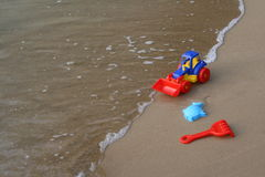 Toy tractor on the sand Royalty Free Stock Photo