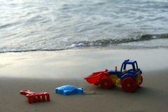 Toy tractor on the sand Royalty Free Stock Images