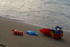 Toy tractor on the sand Stock Photo