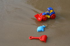 Toy tractor on the sand Stock Images