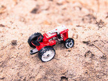 Toy Tractor on the Sand Stock Photography