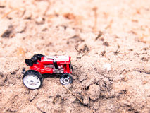 Toy Tractor on the Sand Stock Image
