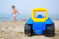 Toy tractor on the seashore stock photography