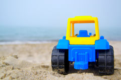 Toy tractor on the seashore Stock Images