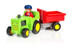 Toy tractor with trailer Stock Photos