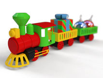 Toy train. Plastic toy train, christmas colors Royalty Free Stock Photos