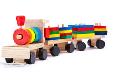 Toy train. Isolated wooden childrens toy train Royalty Free Stock Photo