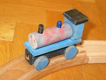 Toy train. A toy wooden train, handmade by father and son - focus is on the face of the train, drawn by the little boy Royalty Free Stock Photos
