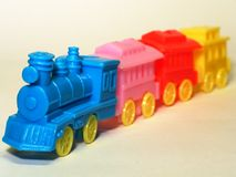 Toy train 2. Toy train on white background, shallow DOF royalty free stock photography
