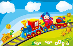Toy train. Rides on the field in the cars driven by Children's Toys Stock Image