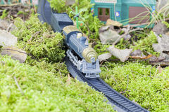 Toy train. Running through the forest moss Royalty Free Stock Images