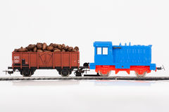 Toy train with coffee beans. Pictured items of a toy railroad Stock Image