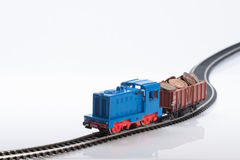 Toy train with coins four. Pictured items of a toy railroad Stock Image