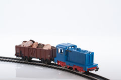 Toy train with coins one. Pictured items of a toy railroad Stock Photo