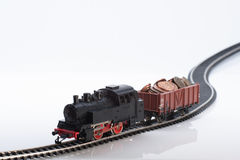 Toy train with coins three. Pictured items of a toy railroad Stock Photos