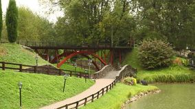 Toy train drives over the bridge in the miniature town stock footage