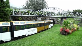 Toy train drives over the bridge stock video