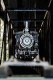 Toy Train engine. Front view of a Toy Steam engine on a bridge Royalty Free Stock Image