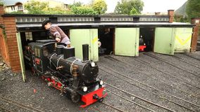Toy train engines miniature Shed stock video footage